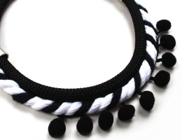 black and white necklace with pom poms