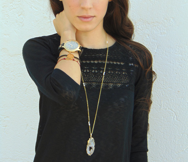 black shirt with watch and pendant