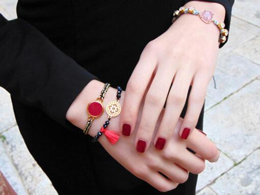 bracelet with red tassels