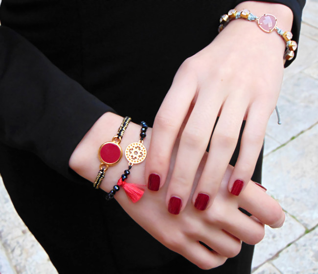 bracelet with red tassels